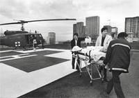 Flown from a distant location, Jim Matilla is rushed to the ER from the Harborview helipad.